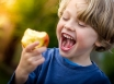 Child eating healthy food after cancer treatment