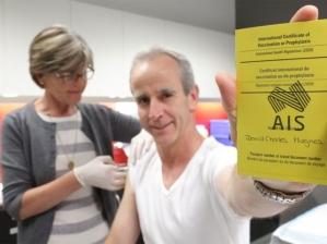 Ruth providing a vaccination to Dr David Hughes